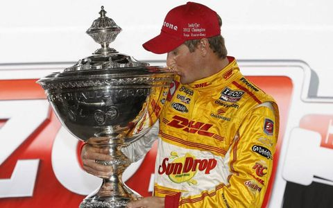 Ryan Hunter-Reay holds his championship trophy after Saturday's race.