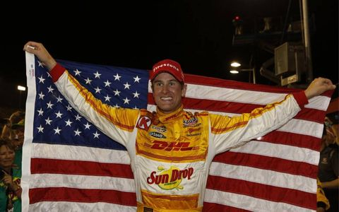 Ryan Hunter-Reay, the first American to win the IndyCar championship since 2006, holds up the American flag.