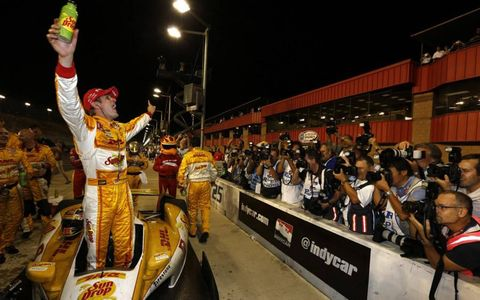Ryan Hunter-Reay celebrates after winning the IndyCar championship.
