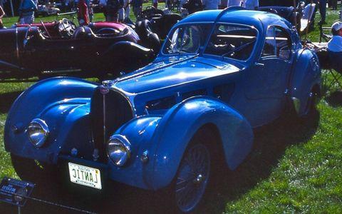 Tire, Motor vehicle, Wheel, Automotive design, Blue, Vehicle, Land vehicle, Classic car, Vehicle door, Automotive tire,