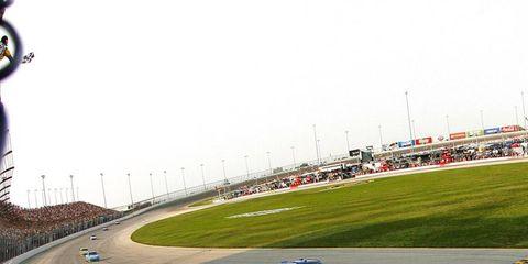 Brad Keselowski speeds over the finish line.