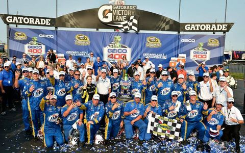 Keselowski and Co. pose for a photo after the team's big win in Chicago.