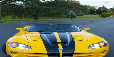 Motor vehicle, Mode of transport, Automotive design, Vehicle, Yellow, Hood, Headlamp, Automotive parking light, Automotive lighting, Car,
