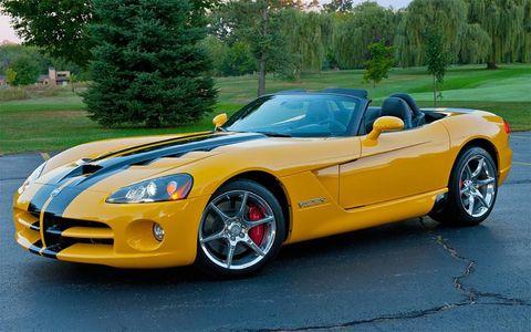 Tire, Automotive design, Vehicle, Yellow, Performance car, Hood, Car, Headlamp, Automotive mirror, Fender,