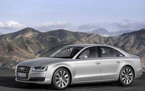 Tire, Wheel, Automotive design, Mountainous landforms, Automotive mirror, Mode of transport, Vehicle, Mountain range, Hill, Grille,
