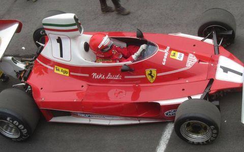 "Actor Daniel Bruhl, aka Niki Lauda, drives through the pits during the filming of ""Rush."""