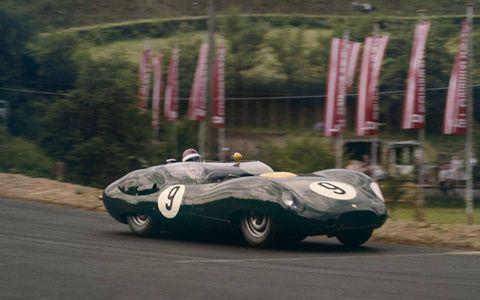 A sleek Lister-Jaguar tackles the Nürburgring in 1959.