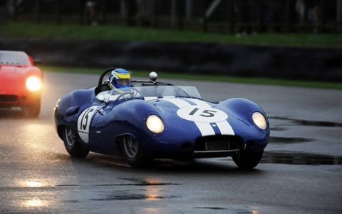 This Lister-Jaguar driver proves that a little precipitation never hurt anyone at the 2013 Goodwood Revival.