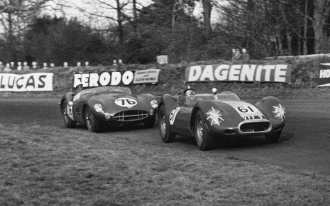 Archie Scott-Brown's Lister-Jaguar leads Stirling Moss' Aston Martin during the 1958 British Empire Trophy race.