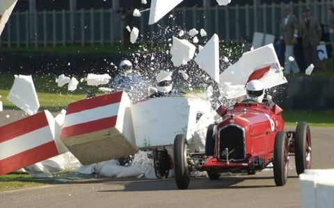 Styrofoam barrier at the chicane explodes as Ian Landy crashes into during the Goodwood Trophy race.