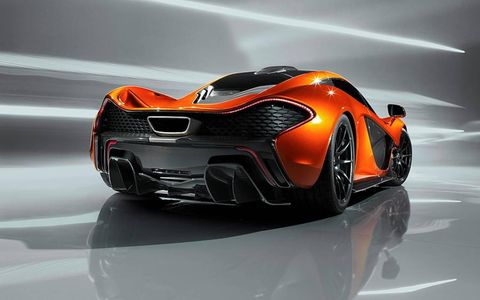A rear view of the McLaren P1 is shown.