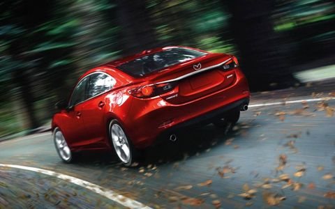 The 2014 Mazda 6i Grand Touring is definitely a good competitor with the Ford Fusion.