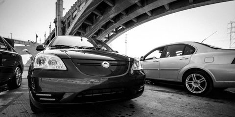 Coda sedans on the edge of the LA River.