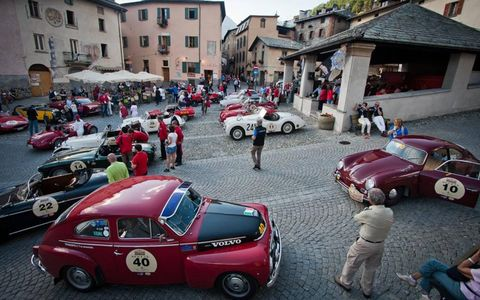 Summer Marathon rallyers gather for a party after the first day of stages in Bormio's Piazza Cavour. The Summer Marathon features pre-1971 classics.