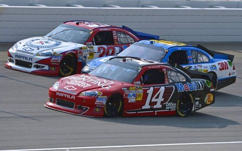 2012 GEICO 400 at Chicagoland Speedway: Tony Stewart, Greg Biffle and Ryan Newman go three wide