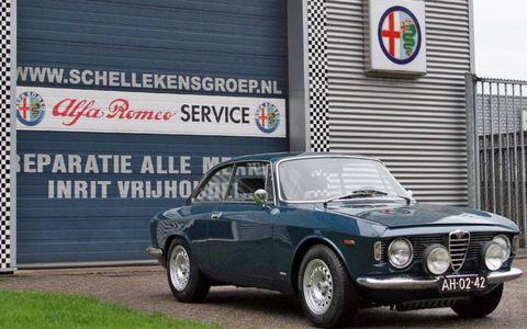 The 1964 Alfa Romeo Giulia Sprint GT riding on new springs, wheels and tires. Not bad at all.