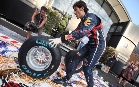 Rubber-Stamped: Pirelli and Formula One artist Mark Dickens at the Italian Grand Prix collaborated with five drivers, including Red Bull Racing's Mark Webber, to create some unique artwork.
