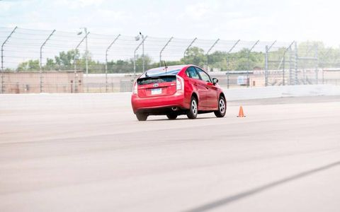 The 2012 Toyota Prius Four hits the slalom course at Michigan International Speedway.