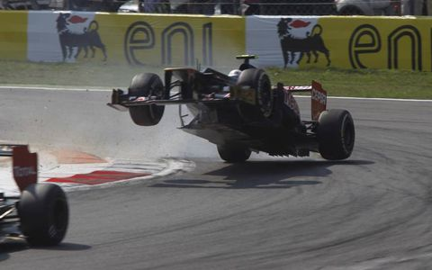 Unintended air //  Jean-Eric Vergne, driver of the Toro Rosso STR7 Ferrari, wrecks at the Formula One Italian Grand Prix in Monza, Italy. Suspension failure was later cited as the cause.