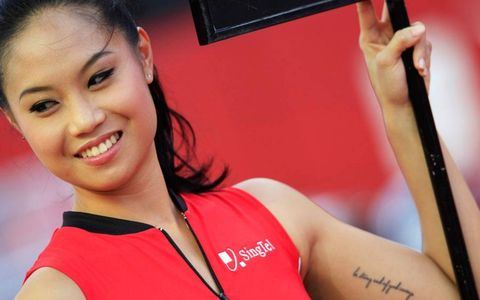 When it comes to being a grid girl in Singapore, sometimes you have to read the fine print.