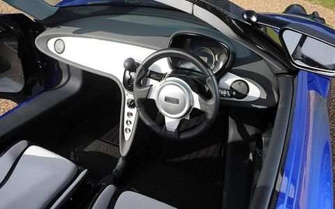 Motor vehicle, Steering part, Mode of transport, Automotive design, Steering wheel, Speedometer, Sports car, Luxury vehicle, Supercar, Personal luxury car,