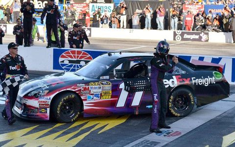 Denny Hamlin hams it up in victory lane with a baseball pose, ala Babe Ruth. After all, Hamlin called his shot by predicting a win.