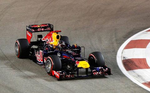 Sebastian Vettel moved into second place in the Formula One points chase with his win in Singapore on Sunday.
