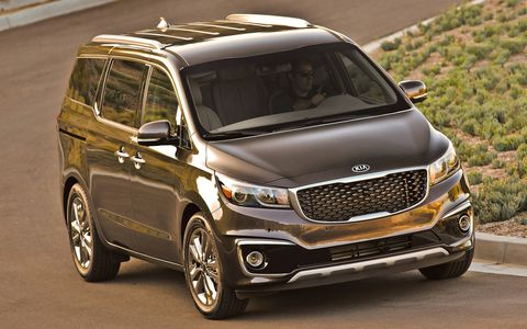 """The 2015 Kia Sedona wears Peter Schreyer's Tiger Nose aesthetic, or what some people dare to call """"design language."""""""