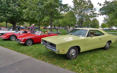 A second generation Dodge Charger mercifully free of Dukes of Hazzard accessories sits next to an MG MGB and a Ferrari Dino GT.