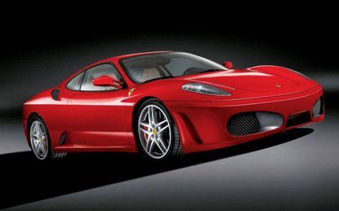 Tire, Wheel, Mode of transport, Automotive design, Vehicle, Performance car, Red, Automotive lighting, Car, Sports car,