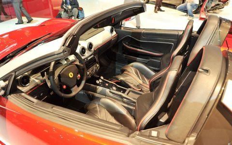 Motor vehicle, Mode of transport, Automotive design, Steering part, Steering wheel, Personal luxury car, Vehicle door, Car seat, Luxury vehicle, Performance car,