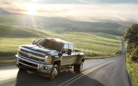 Automotive design, Automotive tire, Vehicle, Road, Land vehicle, Rim, Landscape, Automotive exterior, Hood, Fender,