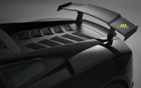 Automotive design, Automotive exterior, Automotive tire, Fender, Carbon, Vehicle door, Hood, Tread, Luxury vehicle, Synthetic rubber,