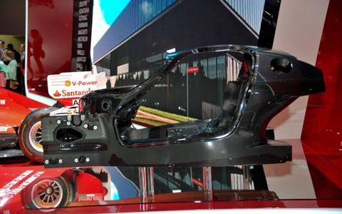 The Enzo's successor will be powered by a mid-mounted V-12 with HY-KERS technology; the carbon fiber tub is on display at the Paris motor show.