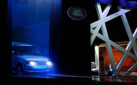 The 2013 Range Rover noses into a shallow pool.
