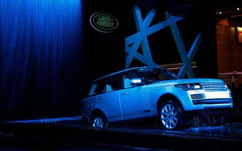 The 2013 Range Rover emerges from the depths in Paris.
