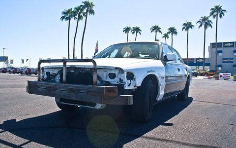 Come to sunny Phoenix, where you can drive cars like this positively apocalyptic Crown Vic!