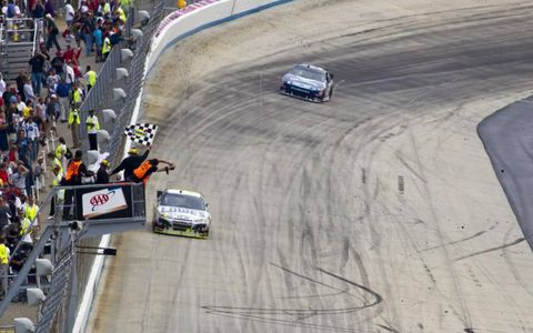 Jimmie Johnson takes the checkered flag at the AAA 400 race at the Dover International Speedway in Dover, DE.
