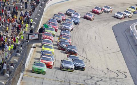 The NASCAR Sprint Cup Series teams take to the track for the AAA 400 race at the Dover International Speedway in Dover, DE.