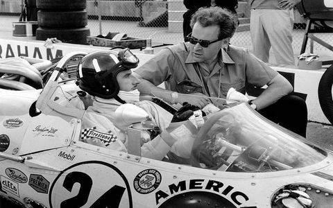Lola founder Eric Broadley chats to Graham Hill at Indy in 1966, where Hill became the first Englishman to win at the Brickyard.