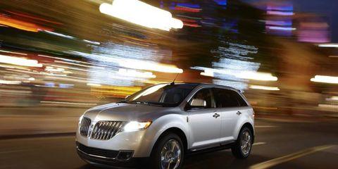 Tire, Automotive design, Vehicle, Infrastructure, Automotive mirror, Automotive lighting, Car, Crossover suv, Fender, Grille,