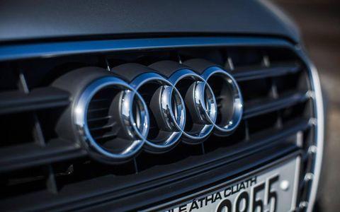 Motor vehicle, Blue, Automotive design, Automotive exterior, Grille, Electric blue, Logo, Light, Azure, Hood,