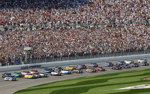 Kevin Harvick leads the field to the green flag at the start of the race