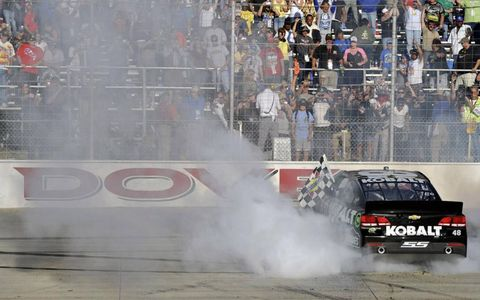 Jimmie Johnson spins out after his win.