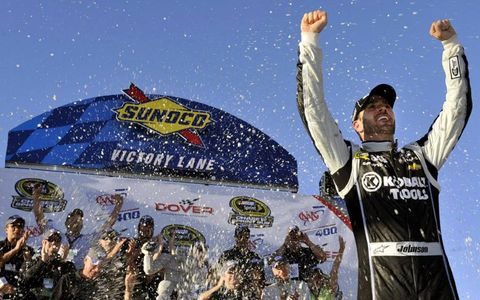 Jimmie Johnson celebrates after his win at Dover.