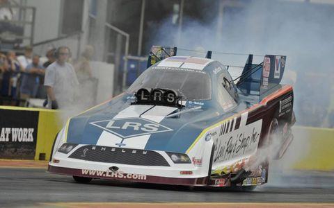 Car, Hood, Motorsport, Automotive exterior, Race car, Racing, Auto racing, Sports car, Logo, Smoke,