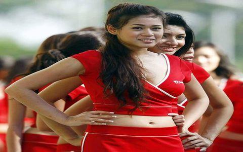 Hair, Face, Mouth, Eye, Cheerleading uniform, Red, Happy, Facial expression, Uniform, Waist,