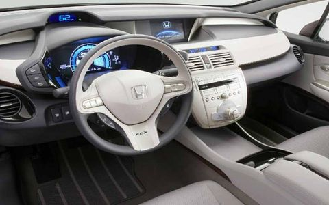 Motor vehicle, Steering part, Blue, Mode of transport, Product, Automotive design, Steering wheel, White, Technology, Car,