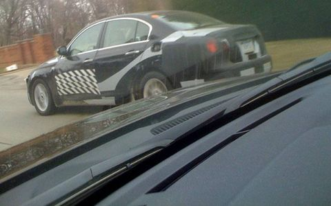 Clay Mandel captures a prototype being road tested--maybe a Hyundai?