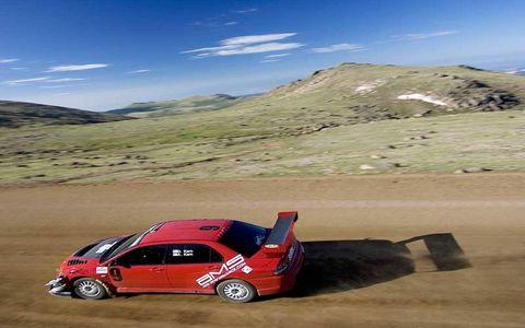 Motor vehicle, Automotive design, Vehicle, Mountainous landforms, Landscape, Car, Highland, Hill, Alloy wheel, Mountain range,